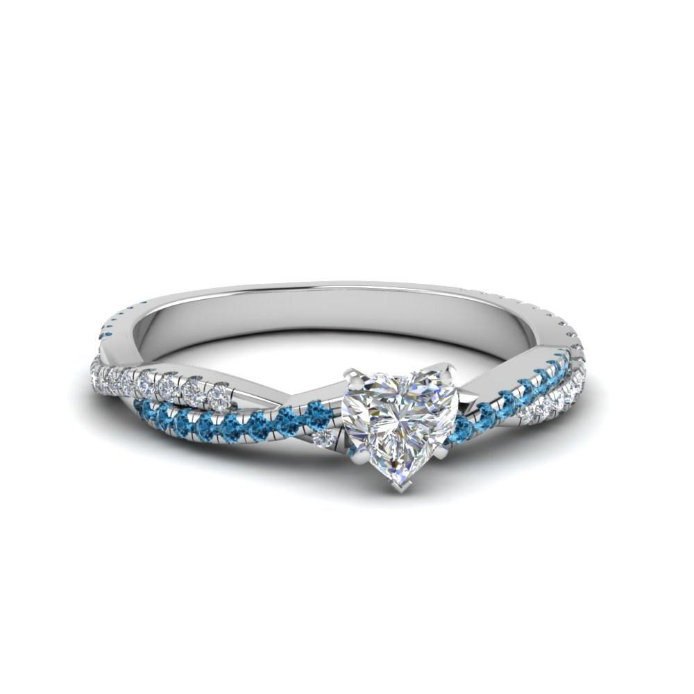 Heart Shaped Ice Blue Topaz Side Stone Engagement Rings