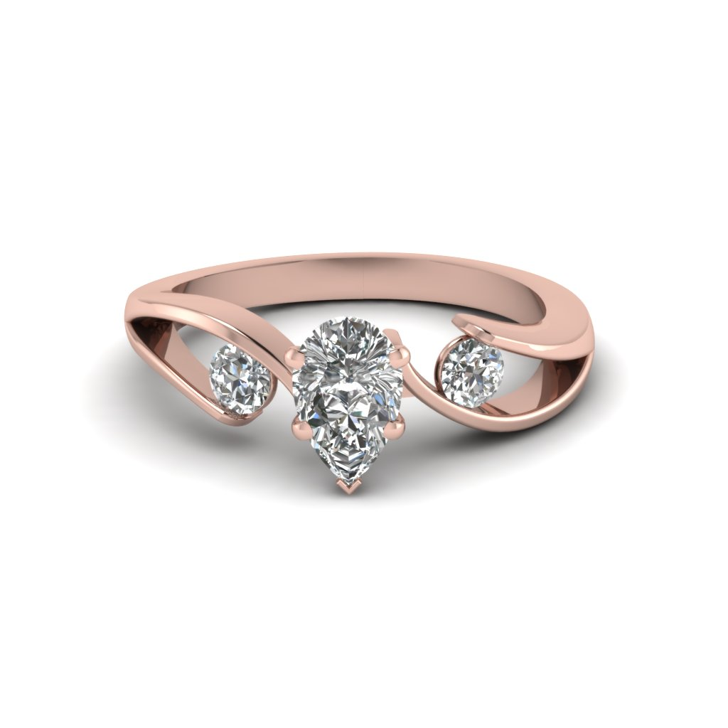 Rose Gold Pear Diamond Three Stone Ring