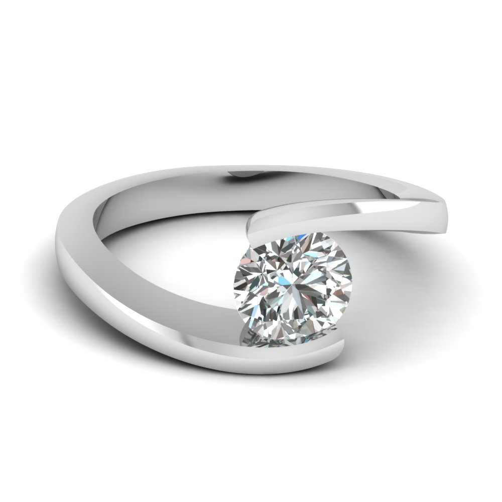 round cut diamond central twist solitaire ring in 14k white gold