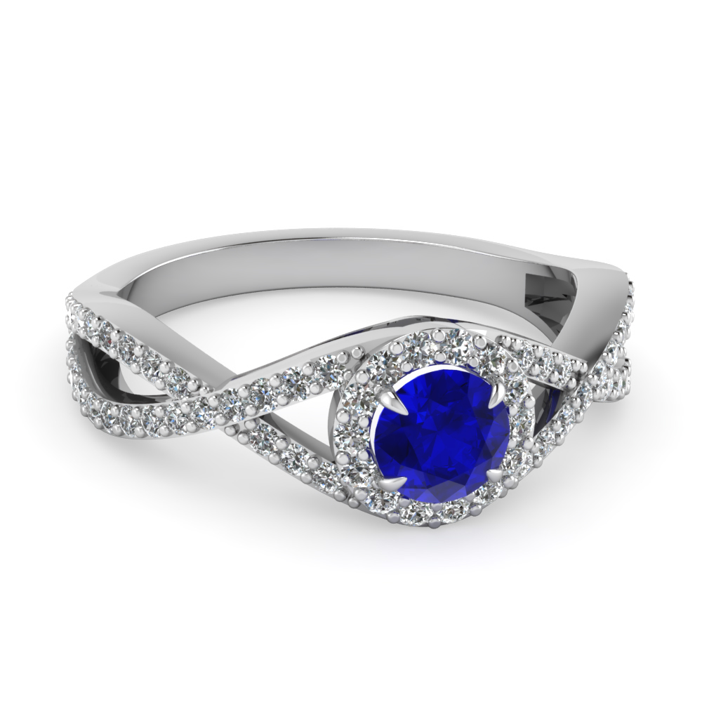 Blue Sapphire And Entwined Diamond Engagement Ring in White Gold
